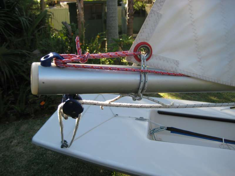 Close-up of laser clew tie-down and outhaul