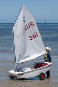 small sailboats on the beach