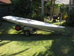 Laser dinghy on dolly and trailer
