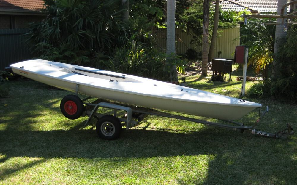 Laser dinghy and dolly on trailer